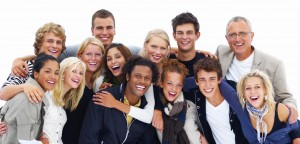 Group of smiling friends against white background